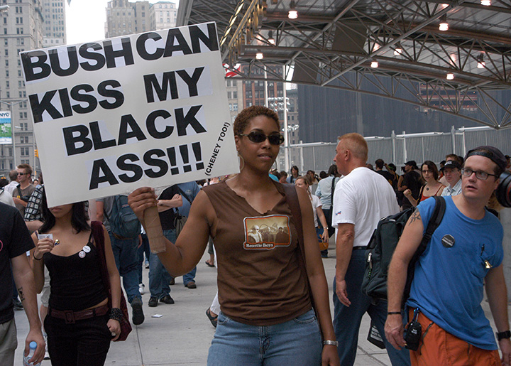 Woman protester at Ground Zero (former site of the World Trade Center) as thousands converged on New York City for demonstrations against the 2004 Republican National Convention (RNC), over the war in Iraq and other issues.
