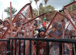 Fence is torn down during protests against the WTO ministerial in Cancún, Mexico in 2003 shortly after the suicide of South Korean farmer Lee Kyung Hae.  PhotoLangelle.org Fence is torn down during protests against the WTO ministerial in Cancún, Mexico in 2003 shortly after the suicide of South Korean farmer Lee Kyung Hae.  PhotoLangelle.org